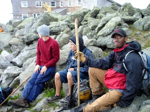 Tired after the long hike to the top (from left to right: REU students Jordan Jessop, Cord Dorcey, and Kadeem Gilber